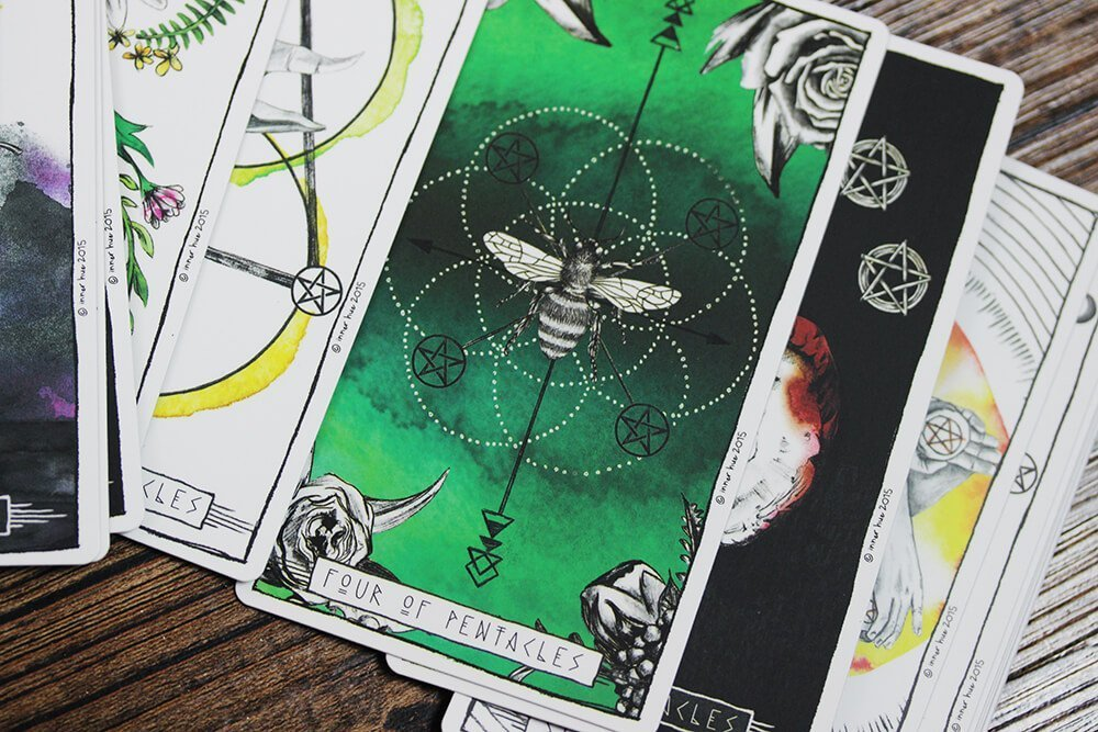 Close up of a scattered deck of tarot cards. Badass Therapy allows clients to preform their own readings, provide alternative therapy, energy healing, massage therapy, and more. Contact us today for therapy for chronic pain, trauma therapy, and remember you're a badass!